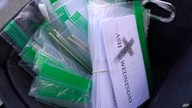 Ash Wednesday packets containing ash, swabs, a printed prayer, and instructions, rest in a basket in front of Grace Episcopal…