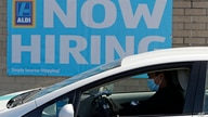 This May 8, 2020 photo shows a hiring sign at the Aldi grocery store in Morton Grove, Ill.   The number of Americans applying…