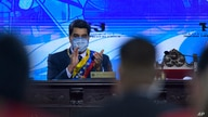 Venezuelan President Nicolas Maduro applauds during a ceremony marking the start of the judicial year at the Supreme Court in…