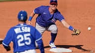 Texas Rangers shortstop Josh Jung can't catch a ball during the sixth inning of a spring training baseball game against the…