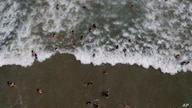 People swim off Los Angeles beach after it recently reopened following a lockdown to contain the spread of COVID-19 in La…