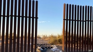 This photo provided by the US Customs and Border Protection shows a hole cut into Southern California's border fence with…