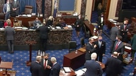 In this image from video, Republican senators and staff talk on the floor after a vote on the motion to allow witnesses in the…