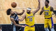 Sacramento Kings forward Marvin Bagley III (35) and Los Angeles Lakers forward Jared Dudley (10) try to get possession of the…