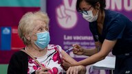 An elderly woman gets a shot of the CoronaVac vaccine for COVID-19 developed by China's biopharmaceutical company Sinovac…