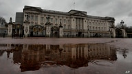 Buckingham Palace is reflected in a rain puddle in London, Wednesday, March 10, 2021. In countries with historic ties to Great…