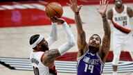 Portland Trail Blazers forward Carmelo Anthony, left, hits a shot over Sacramento Kings guard DaQuan Jeffries during the second…