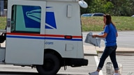 A postal worker loads a delivery vehicle at the United States Post Office in Cranberry Township, Pa., Wednesday, Aug. 19, 2020…
