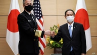 Adm. Philip Davidson, left, commander of the U.S. Indo-Pacific Command, poses with Japan's Prime Minister Yoshihide Suga for a…