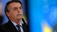 Brazil's President Jair Bolsonaro speaks at a ceremony announcing economic measures to support philanthropic hospitals and help…