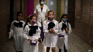 Students leave the classroom for a break on their first day back to in-person class amid the COVID-19 pandemic at a public…