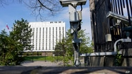 Security cameras are seen on the grounds of the Embassy of the Russian Federation in Washington, Thursday, April 15, 2021. The…