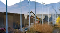 FILE - Crews construct a section of border wall in San Bernardino National Wildlife Refuge, Tuesday, Dec. 8, 2020, in Douglas,…