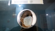 A nurse waits to vaccinate a a group of elderly with the Sputnik V COVID-19 vaccine at the Perez Carreno public hospital in…