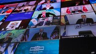World leaders virtually attend the Leaders Summit on Climate, as seen from the East Room of the White House, Thursday, April 22…