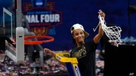 Stanford guard Kiana Williams (23) cuts down the net after the championship game against Arizona in the women's Final Four NCAA…