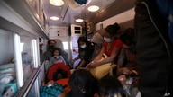 Migrants deported from the U.S. sit in an ambulance as they are driven to a shelter in Ciudad Juarez, Mexico, Tuesday, March 23…