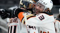 Anaheim Ducks left wing Max Comtois (53) hugs goaltender Anthony Stolarz (41) after a 4-0 victory against the San Jose Sharks…