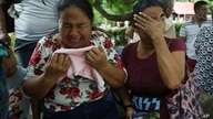 Women cry as they explain that three of their relatives were killed the previous day in El Ripial, Apure state, Venezuela,…