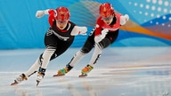 Chinese skaters compete in the women's 500 meters short track speed skating race during a test event for the 2022 Beijing…