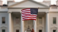 FILE - In this Sept. 2017 file photo, a flag is waved during an immigration rally outside the White House, in Washington.  The…