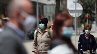 People, wearing protective face masks, stand in a line as they wait to be tested for COVID-19, amid a reinstated strict…