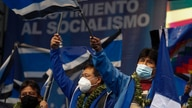 Bolivia's President Luis Arce, center, and former President Evo Morales, right attend the Movement Toward Socialism, MAS, party…