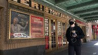 A woman walks past the Walter Kerr Theatre, Thursday, May 6, 2021, in New York where Hadestown was showing before the…