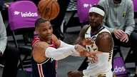 Washington Wizards guard Russell Westbrook (4) passes the ball as he is guarded by Indiana Pacers guard Aaron Holiday (3)…