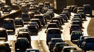 FILE - In this Nov. 15, 2016 file photo, morning rush hour traffic makes its way along US 101 near downtown Los Angeles. Car…