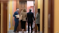 White House officials arrive for a meeting at the Capitol in Washington, Wednesday, June 23, 2021. Congressional negotiators…