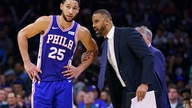 Philadelphia 76ers' Ben Simmons, left, listens to assistant coach Ime Udoka, right, during the second half of an NBA basketball…