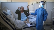 Blanca Ortiz, 84, celebrates after learning from nurses that she will be discharged from the Eurnekian Ezeiza Hospital on the…