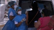 A healthcare workers inoculate women with the AstraZeneca COVID-19 vaccine, outside the Rommel Fernandez soccer stadium where…