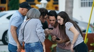 People wait for information after a partial building collapse, Thursday, June 24, 2021, in Surfside, Fla. (AP Photo/Wilfredo…