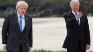 Britain's Prime Minister Boris Johnson poses with U.S. President Joe Biden during arrivals for a G7 meeting at the Carbis Bay…