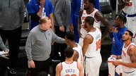 New York Knicks coach Tom Thibodeau talks with the team during the second half in Game 4 of an NBA basketball first-round…