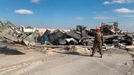 U.S. soldiers clear rubble from a site of Iranian bombing at Ain al-Asad air base in Anbar, Iraq, Monday, Jan. 13, 2020. Ain al…