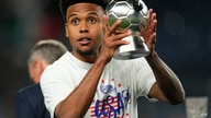 United States' Weston McKennie (8) holds his MVP trophy after a team win against Mexico in the CONCACAF Nations League…