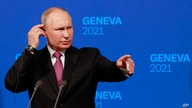 Russia's President Vladimir Putin gestures as he addresses the media during a press conference after the U.S.-Russia summit…