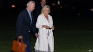 President Joe Biden and first lady Jill Biden walk on the Ellipse near the White House in Washington, as they arrive from a…
