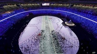 Athletes march in during the opening ceremony at the Olympic Stadium at the 2020 Summer Olympics, Friday, July 23, 2021, in…