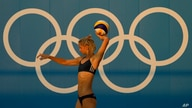 Germany's Laura Ludwig throws the ball during a Beach Volleyball training session ahead of the 2020 Summer Olympics, Tuesday,…
