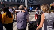 A woman gets a hug upon arrival at Ezeiza International airport on the outskirts of Buenos Aires, Monday, Dec. 21, 2020. The…