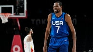 United States' Kevin Durant (7) reacts during men's basketball quarterfinal game against Spain at the 2020 Summer Olympics,…