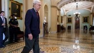 Senate Minority Leader Mitch McConnell, R-Ky., leaves the chamber as the Senate works to advance the $1 trillion bipartisan…