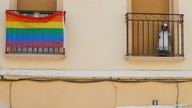 A rainbow flag hangs from the window of a house during the International LGBT Pride Day, in Villanueva de Algaidas