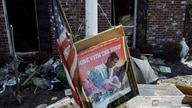 "FILE PHOTO: A movie poster for ""Gone with the Wind"" sits in a front yard of a home damaged by Hurricane Katrina in Chalmette"