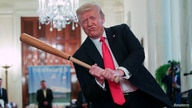 U.S. President Trump swings baseball bat at Spirit of America Showcase event at the White House in Washington