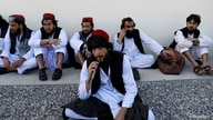 FILE PHOTO: Newly freed Taliban prisoners sit at Pul-i-Charkhi prison, in Kabul, Afghanistan